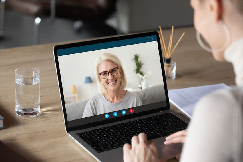 Elderly lady and young lady connecting via video call