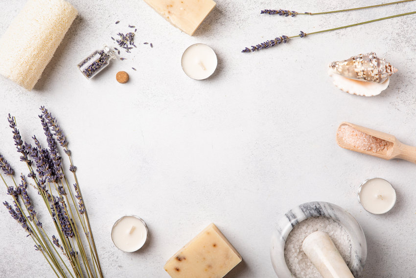 Flat-lay of self-care items, including lavender and tea light candles.